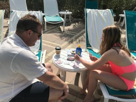 Playing cards by the pool